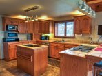 Step into the fully equipped kitchen where you can prepare home-cooked meals.