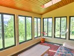 Through the living room, head out onto the screened porch where you can enjoy your morning coffee as you take in the...