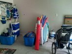 Boogie Boards, Coolers, Snorkel and Pool Gear/Toys and Stroller in Garage