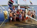 A group of tourists enjoy swimming on the Nile during their trip on Felucca