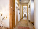 light airy hallway, with lounge, main bathroom and master bedroom