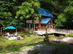Creekside Cabin with patio complete with fire kettle,Charcoal grill,  hammock and hot tub over creek