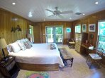 Spacious Master opens onto deck.  Privacy in the treetops.