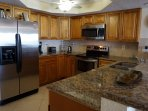 Beautiful wood cabinets with granite counters & stainless steel appliances.