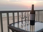 Enjoy a glass of wine on the balcony at Sunset.