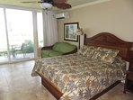 View of queen bed, full pull out couch, ceiling fan.