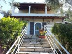 Steps from olive grove up to the large private patio
