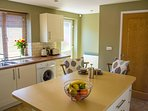 Kitchen, sunny and bright, leads into the dining room.