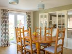 A very sociable dining room, seating for six, doors open into the kitchen, for chats with 'the chef'
