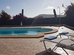 Relax by the pool in the peaceful surroundings enjoying the warm lanzarote climate
