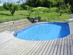 There's decking and loungers for relaxing by the pool