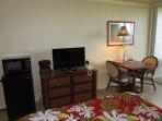 TV, micro, fridge, sitting area.