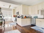 Newly renovated kitchen with everything needed to cook including basic spices and small appliances
