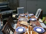 Outside dining table seats up to 8 with 4 burner gas BBQ