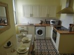 Large fully equipped kitchen with dining table and chairs