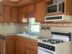 Fully equipped kitchen with Gas stove and Oven!