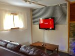 Wall mounted TV with HD Netflix account!