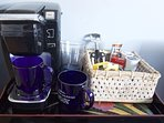 Keuring coffee maker with coffee pods, tea, snacks.