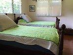 Second bedroom, with antique koa (a treasured Hawaiian wood) twin beds.