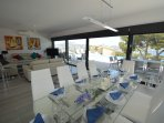 Large family dining table with magnificent views overlooking the pool and sea