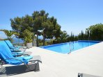 10 comfortable sunbeds on a large terrace with outdoor shower