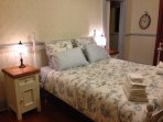 Queen size bed in another spacious bedroom with Ensuite