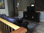 Open Area at top of steps with Queen Sleeper Sofa with Gel Foam mattress