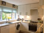 The well-equipped kitchen eases the cooking and clearing up