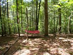 Admire the lush green views from the hammock. Let the breeze calm you - take a nap.