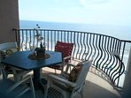 Endless possibilities! Enjoy meals and drinks here (1 of 2 oceanfront balconies) ...