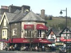 Vibrant Windermere with railway station and a wealth of shops/eateries is a 15 minute walk away