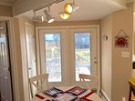 double door entry into dining area off large front deck with storage closet