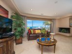 Living Room is furnished with 2 huge and comfortable sofas, a single bed, flatscreen cable TV
