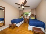 Bedroom 3 has two plush twin beds with dresser, and writing desk