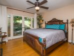 1st bedroom is beautifully furnished with a queen bed, a dresser, HD cable TV