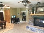 The fireplace hearth doubles as additional Great Room seating.