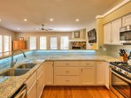 Granite countertops elevate the cooking space.