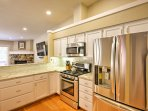 The kitchen includes stainless steel appliances, a french door refrigerator and ample counter space to make meal prep a...