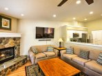 Sink into the comfortable furnishings in the living area while enjoying the warmth from the gas-burning fireplace.