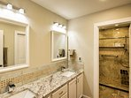 The en suite bathroom off the master bedroom features a spacious walk-in shower and double vanity.