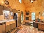 Hardwood floors meet your feet when you step inside the lovely cabin.