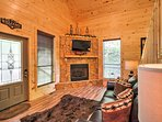 Watch your favorite shows on the flat-screen cable TV near the gas fireplace.