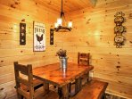 Gather around the charming wooden dining table to enjoy your meals.