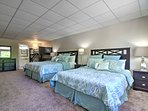 With a king-sized bed, queen-sized bed and a twin-over-twin bunk bed, this room has plenty of space to accommodate...