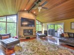 Mahogany floors and vaulted, 15-foot cedar ceilings welcome you upon entering the wide-open living room in your...