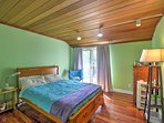 Drift off to a peaceful sleep on this bedroom's comfortable full-sized bed.