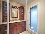 Wake up and wash off in the pristine walk-in shower to prepare for another exciting day!