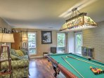 For extra entertainment, head to the home's finished basement for a friendly game of pool in front of the fire.