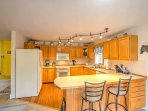 In the fully equipped, hardwood-floor kitchen you'll have all the space and appliances needed to whip up home-cooked...