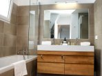 Master bathroom with tub, shower and toilet